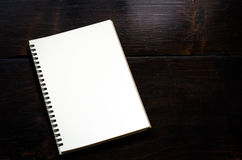 White notebooks laying on black table. Stock Image