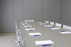 White notebooks laying on a grey table for negotia Stock Photo