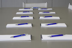 White notebooks laying on a grey table for negotia Royalty Free Stock Photos