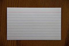 White notecard on wood table Royalty Free Stock Images