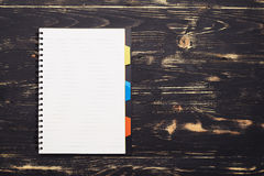 White notepad on dark wooden table Royalty Free Stock Photo