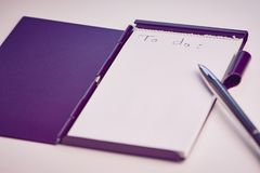 White notepad with the English words: to do stock image