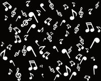 White notes. White musical notes on a black background Stock Photo
