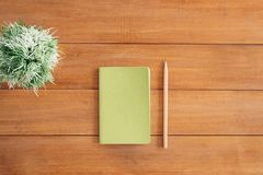 White Notes Beside a Pencil on Brown Wooden Surface royalty free stock photo