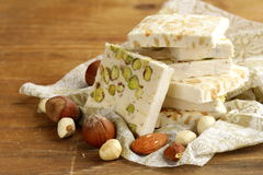 White nougat with different nuts Stock Images