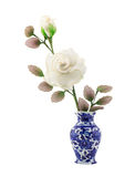 White nylon fabric flower in blue ceramic vase. On isolate white background stock photography