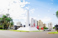 White obelisk on downtown of the city on the Afonso Pena avenue. Campo Grande, Brazil - February 24, 2018: White obelisk on downtown of the city on the Afonso Stock Photography