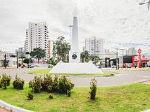 White obelisk on downtown of the city on the Afonso Pena avenue. Campo Grande, Brazil - February 24, 2018: White obelisk on downtown of the city on the Afonso Stock Photo