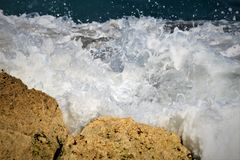 White Foam from the Ocean Waves Soak the Rocks of Boca Beach royalty free stock photo