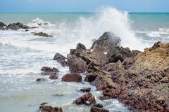 White Ocean Waves Crashing Over Coastal Sea Rocks In Summer.Thailand. Stock Images
