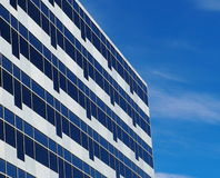 White Office Building With Blue Sky Reflection Stock Image