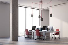 White office corner, red chairs. White office corner with columns, a concrete floor, panoramic windows and computer desks with red chairs. 3d rendering mock up Royalty Free Stock Images