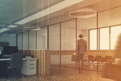 White office corner wooden desks concrete toned Stock Photo