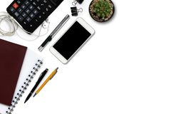 White office desk with calculator, wallet, and supplies. Top vie Stock Photography