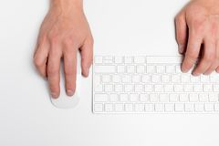 White office desk with computer and supplies. Tabletop. Top view with space for your text.  royalty free stock photo
