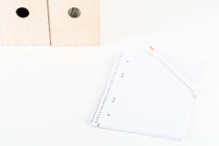White office desk with empty notepad, pencil and folders Royalty Free Stock Images