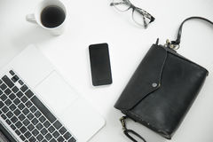 White office desk with keyboard, glasses, coffee, mobile phone, Royalty Free Stock Image