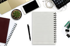 White office desk with smartphone with black screen, pen, laptop Stock Images