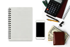 White office desk with smartphone with black screen, pen, wallet Royalty Free Stock Photo