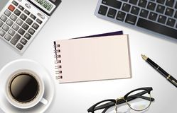 White office desk table with laptop, calculator,pen, cup of coffee,notepad and glass. Top view with copy space, flat lay. Royalty Free Stock Images