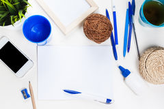 White office desk table with a lot of things on it Royalty Free Stock Photos