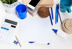 White office desk table with a lot of things on it Stock Photo