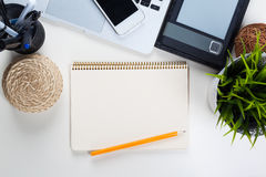 White office desk table with a lot of things on it Royalty Free Stock Images