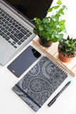 White office desk table with a lot of things on it. Top view with copy space, flat lay Royalty Free Stock Images