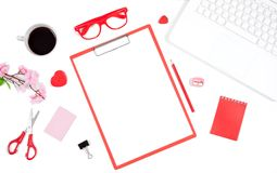 White office desk table with notebook, computer keyboard, clipboard and office supplies. Top view with copy space, flat lay royalty free stock images