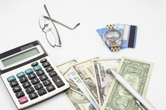 White office desk table with pen calculator glasses and banknote Royalty Free Stock Photography
