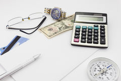 White office desk table with pen calculator glasses and banknote Stock Photos