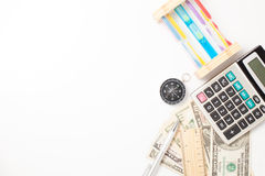 White office desk table with pen calculator hourglass compass  a Royalty Free Stock Photo