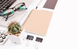 White office desk table, workspace office with laptop, smartphone black screen, pen, calculator, glasses, Top view with copy space.  royalty free stock photos