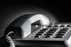 White Office Desk Telephone with Coiled Phone Cord Stock Image