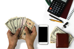 White office desk with US Dollars Count , smartphone with black Royalty Free Stock Images