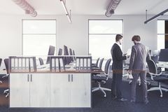 White office interior bookcase, people Stock Image