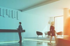 White office reception desk and waiting area toned Stock Photography