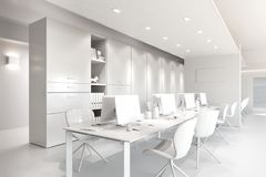 White office interior with a row of chairs, long table and computers Royalty Free Stock Photo