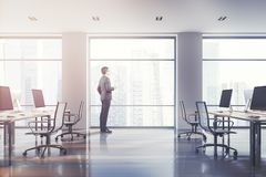 White office interior side view, man in suit stock image