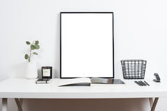 White office interior, stylish work table space with poster artw Stock Images
