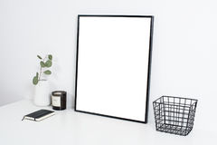 White office interior, stylish work table space with poster artw Royalty Free Stock Photography