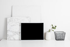 White office interior, stylish work table space with poster artw Royalty Free Stock Photos