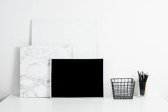White office interior, stylish work table space with poster artw Royalty Free Stock Image