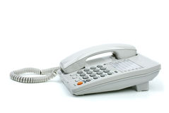 White office phone with handset on-hook. Isolated on the white background Royalty Free Stock Photo