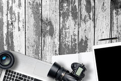 White office photography desk table with laptop, tablet, camera and glass on wooden backgroung. Top view with copy space. Flat lay stock images