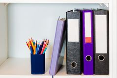 Shelf with folders, organizer and pencil holder Stock Photos