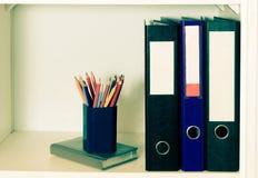 Office shelf with folders. Vintage tone. Stock Image