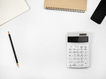 White office table with calculator. White office table with calculator, Top view with copy space Royalty Free Stock Images
