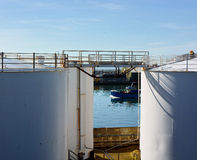 White oil Storage tanks and boat Royalty Free Stock Photography
