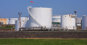 White Oil Tanks. Several white storage tanks for oil at a refinery royalty free stock photo